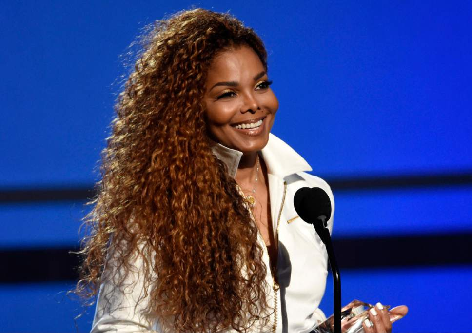 FILE - In this June 28, 2015, file photo, Janet Jackson accepts the ultimate icon: music dance visual award at the BET Awards in Los Angeles. (Photo by Chris Pizzello/Invision/AP, File)