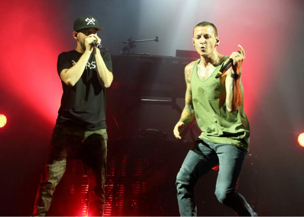 "FILE - In this Aug. 15, 2014 file photo, Mike Shinoda, left, and Chester Bennington of the band Linkin Park perform in concert during their ""Carnivores Tour 2014"" at the Susquehanna Bank Center in Camden, N.J.   (Photo by Owen Sweeney/Invision/AP, File)"
