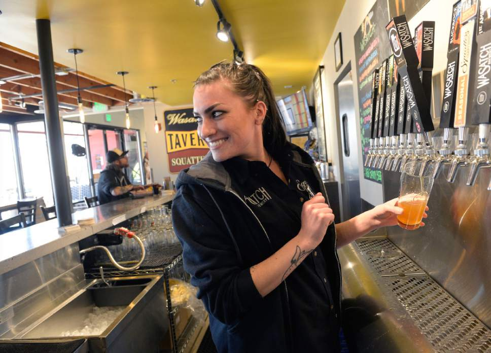 Al Hartmann      Tribune file photo Bartender Jordan Gonzales pours a cold beer for a lunch customer at the West Side Tavern, a new bar that has opened as part of the Wasatch/Squatters Beer Store at 1763 W. 300 South in Salt Lake City.