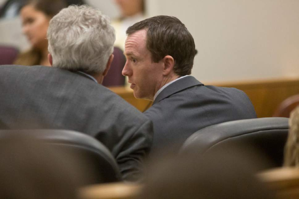 Conrad Truman, right, speaks with Mark Moffatt, his defense attorney, during the coming arguments for the new Conrad Truman murder trail on Thursday, Feb. 23, 2017 at the Fourth Judicial District Court in Provo.  Sammy Jo Hester, Daily Herald