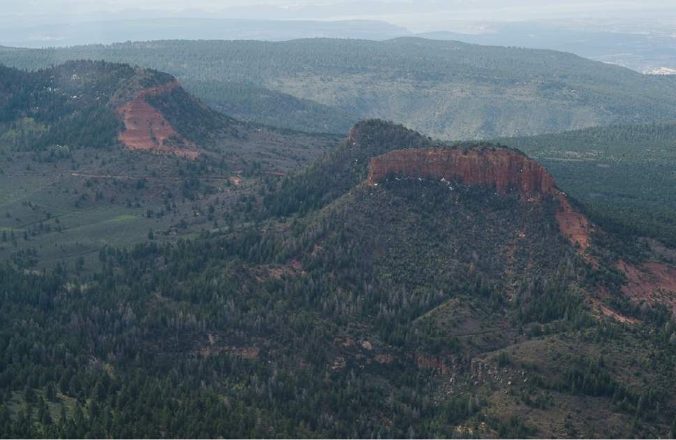 Francisco Kjolseth   The Salt Lake Tribune The two buttes that make up the namesake for the Bears Ears National Monument reveal the vast landscape surrounding them as part of the 1.35 million acres in southeastern Utah protected by President Barack Obama on Dec. 28, 2016. Utah Republicans in Congress are advocating for Trump to jettison Utah's national monument designation.