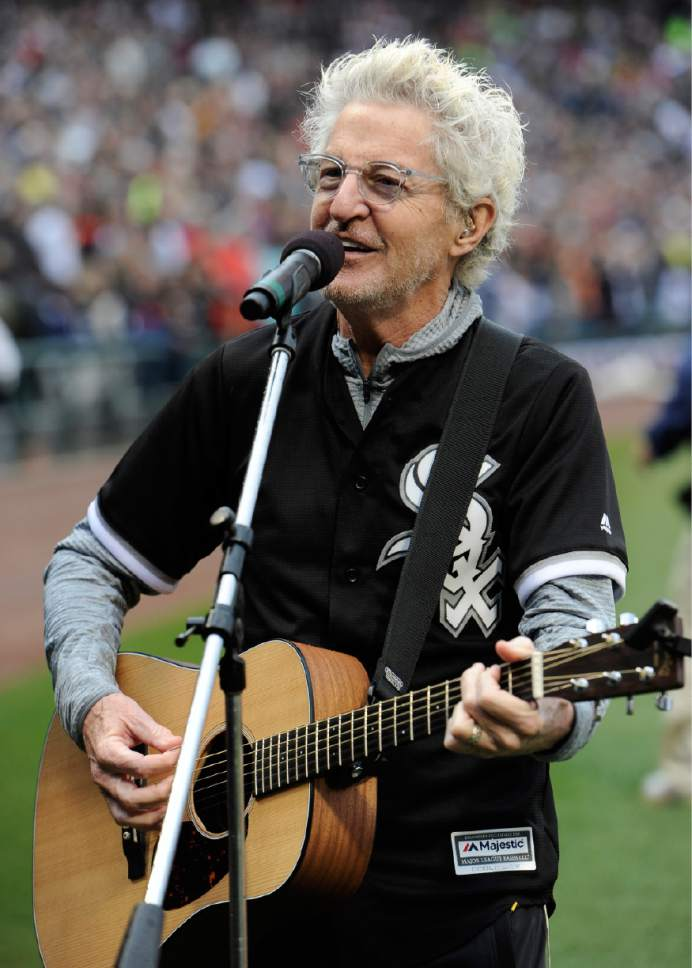 REO Speedwagon lead singer Kevin Cronin sings the national anthem at Guaranteed Rate Field before an MLB baseball game between the Chicago White Sox and Detroit Tigers on opening day Monday, April 3, 2017 in Chicago. (AP Photo/Paul Beaty)