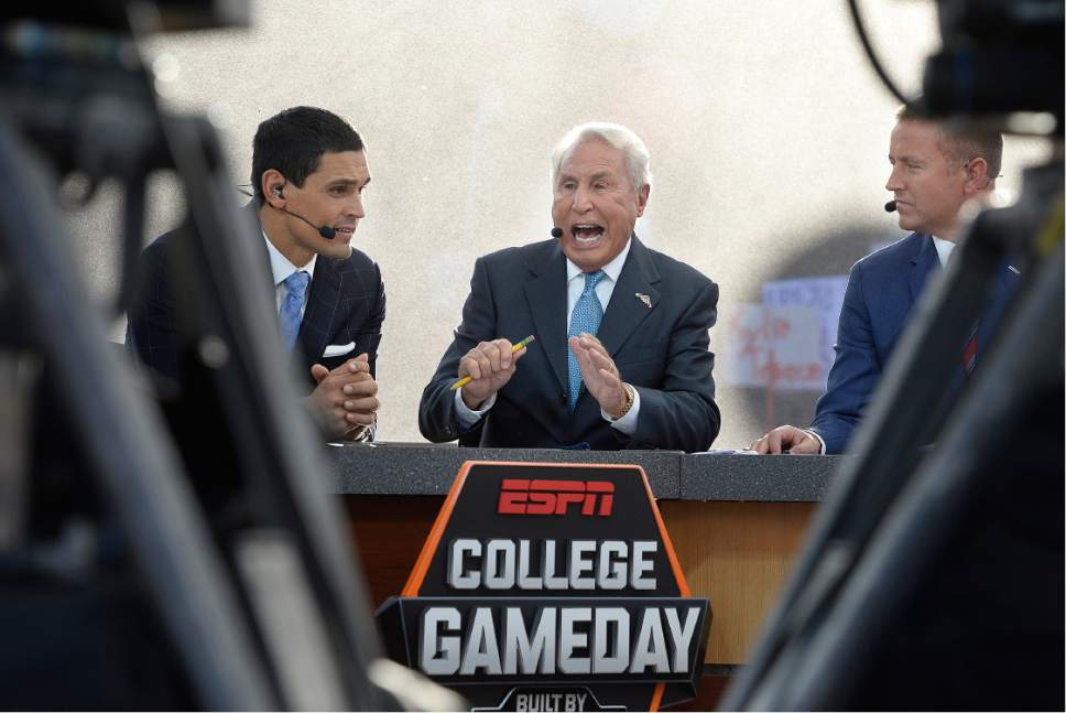 Scott Sommerdorf   |  The Salt Lake Tribune   ESPN college football commentators David Pollack, left, Le Corso, and Kirk Herbstreit talk about the Washington at Utah matchup on College Gameday at President's Circle on the University of Utah campus, Saturday, October 29, 2016.