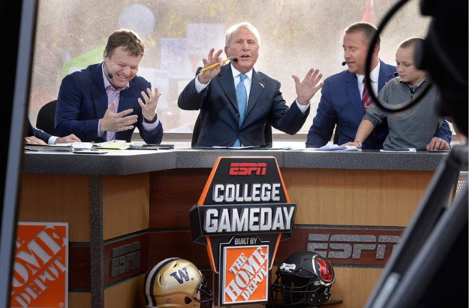 Scott Sommerdorf      The Salt Lake Tribune   ESPN college football commentator Lee Corso, does his thing as he talks abut the Washington / Utah matchup on the set of College Gameday at President's Circle on the University of Utah campus, Saturday, October 29, 2016. At left is Frank Caliendo, and at right is Kirk Herbstreit.