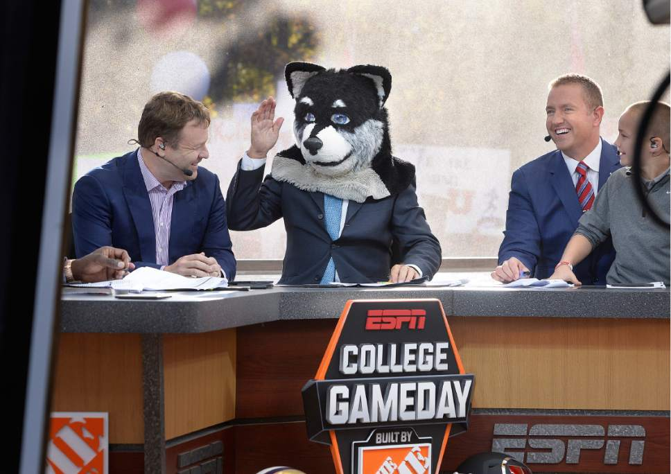 Scott Sommerdorf   |  The Salt Lake Tribune   ESPN college football commentator Lee Corso picks Washington to win the matchup with Utah by donning the Husky mascot's head during College Gameday at President's Circle on the University of Utah campus, Saturday, October 29, 2016. At left is ventriloquist Frank Caliendo, and at right is Kirk Herbstreit.