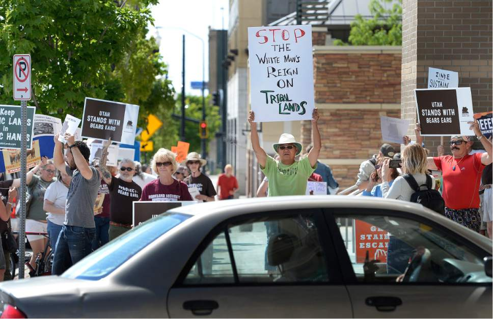 Scott Sommerdorf | The Salt Lake Tribune Protestors chanted in favor of the Bears Ears Monument as cars left the Gateway Shopping Mall near the BLM offices. They were hoping to get a glimpse of Secretary of the Interior Ryan Zinke who spoke at a brief press conference after having met with members of the Bears Ears Commission Sunday at the Bureau of Land Management office at the Gateway in Salt Lake City, Sunday, May 7, 2017.