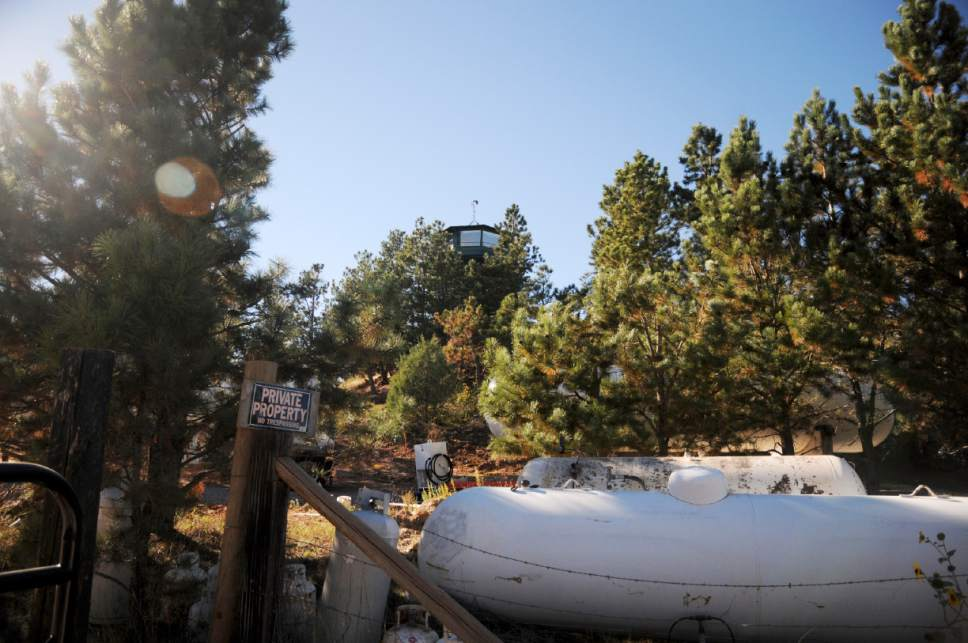 This Monday, Oct. 12, 2015 photo shows the compound of a polygamist group in Pringle, S.D. The group is again going before state regulators Wednesday, Oct. 14, 2015, as part of a request to draw water more quickly at its remote Black Hills compound. The application faces opposition from nearby landowners. (AP Photo/James Nord)