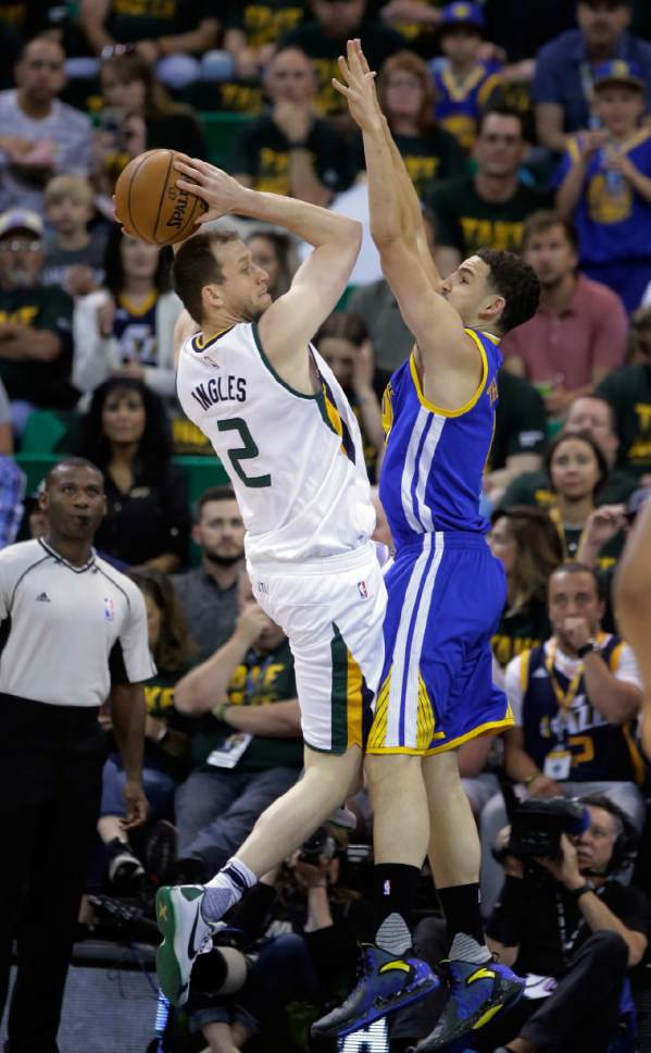 Utah Jazz forward Joe Ingles (2) goes to the basket as Golden State Warriors guard Klay Thompson, right, defends in the first half during Game 4 of the NBA basketball second-round playoff series, Monday, May 8, 2017, in Salt Lake City. (AP Photo/Rick Bowmer)