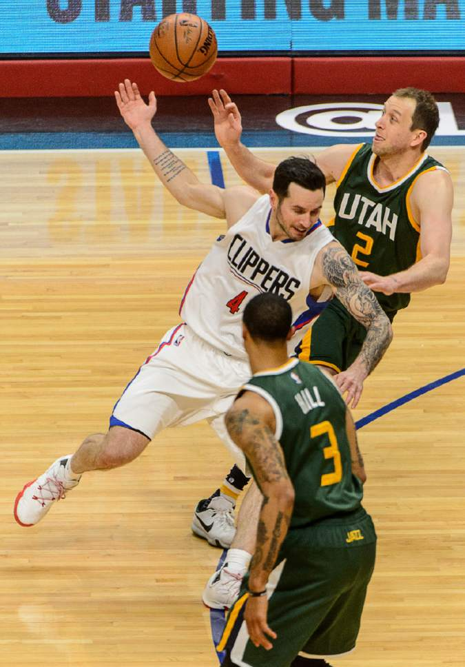 Trent Nelson  |  The Salt Lake Tribune Utah Jazz forward Joe Ingles (2) knocks the ball away from LA Clippers guard JJ Redick (4) as the Utah Jazz face the Los Angeles Clippers in Game 7 at STAPLES Center in Los Angeles, California, Sunday April 30, 2017.