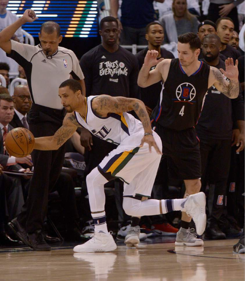 Leah Hogsten  |  The Salt Lake Tribune  Utah Jazz guard George Hill (3) pulls in a loose ball. The Utah Jazz lead the Los Angeles Clippers after the first quarter during Game 3 of their first-round Western Conference playoff series at Vivint Smart Home Arena, Friday, April 21, 2017.