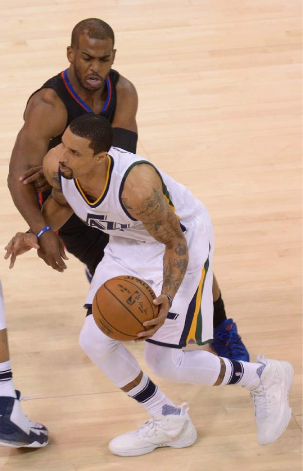 Leah Hogsten  |  The Salt Lake Tribune  Utah Jazz guard George Hill (3) draws a foul on LA Clippers guard Chris Paul (3). The Utah Jazz trail the Los Angeles Clippers 59-62 in the third quarter during Game 6 at Vivint Smart Home Arena, Friday, April 28, 2017 during the NBA's first-round playoff series.