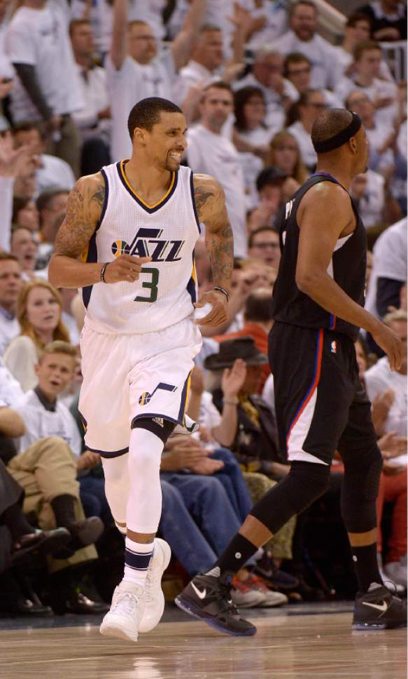 Leah Hogsten  |  The Salt Lake Tribune  Utah Jazz guard George Hill (3) celebrates a 3-point sink. The Utah Jazz lead the Los Angeles Clippers after the third quarter during Game 3 of their first-round Western Conference playoff series at Vivint Smart Home Arena, Friday, April 21, 2017.