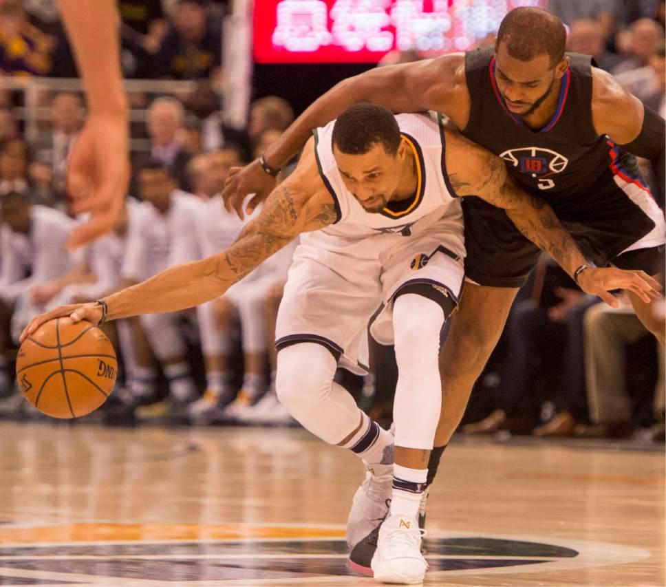 Rick Egan  |  The Salt Lake Tribune  Utah Jazz guard George Hill (3) tries to get down court as LA Clippers guard Chris Paul (3) defends, in NBA action Utah Jazz vs. LA Clippers, in Salt Lake City, Monday, March 13, 2017.