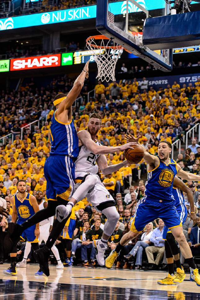 Trent Nelson  |  The Salt Lake Tribune Utah Jazz forward Gordon Hayward (20) looks to pass around Golden State Warriors center JaVale McGee (1) as the Utah Jazz host the Golden State Warriors in Game 3 of the second round, NBA playoff basketball in Salt Lake City, Saturday May 6, 2017. Golden State Warriors guard Klay Thompson (11) at right.