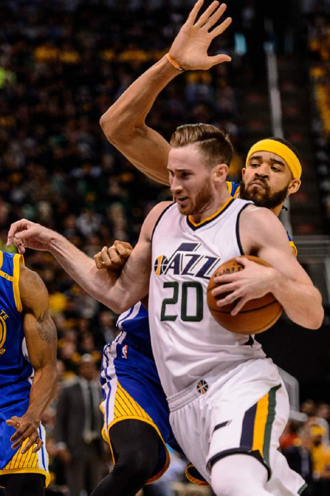 Trent Nelson  |  The Salt Lake Tribune Utah Jazz forward Gordon Hayward (20) is fouled by Golden State Warriors center JaVale McGee (1) as the Utah Jazz host the Golden State Warriors in Game 3 of the second round, NBA playoff basketball in Salt Lake City, Saturday May 6, 2017.