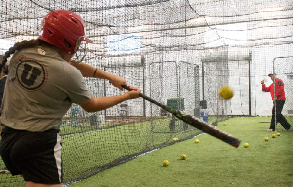 Rick Egan  |  The Salt Lake Tribune  Former USA Softball pitcher and Utah's pitching coach, Cody Thomson pitches batting practice to Hannah Flippen at the University of Utah, Wednesday, April 15, 2015.