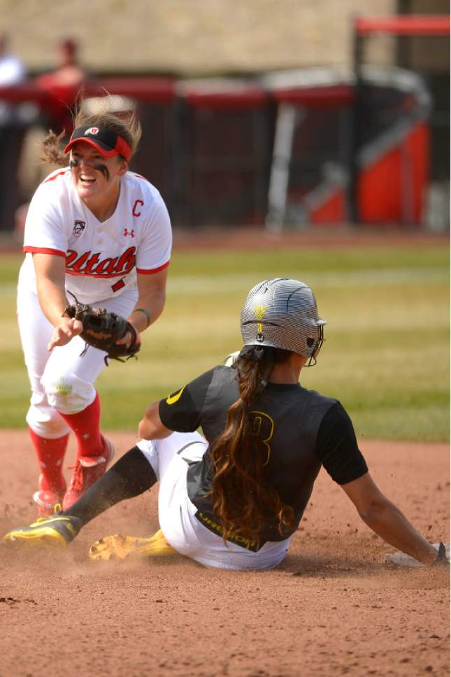 Leah Hogsten  |  The Salt Lake Tribune Utah's Hannah Flippen outs Oregon's Nikki Udria at second. The University of Utah softball team was defeated during their home debut, Saturday, by Oregon, 4-2, March 21, 2015 .