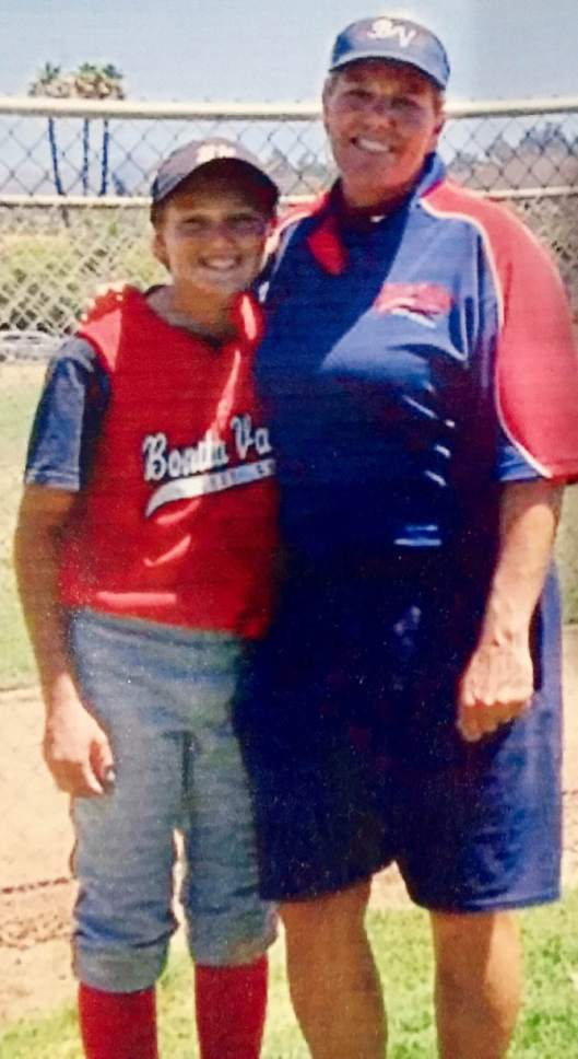 |  Courtesy Mary Lou Flippen  Mary Lou Flippen, right, poses with her daughter Hannah Flippen when Hannah was a youth player. One of the most decorated  pitchers in Utah State history, Mary Lou now cheers on Utah, where her daughter is a standout junior second baseman.