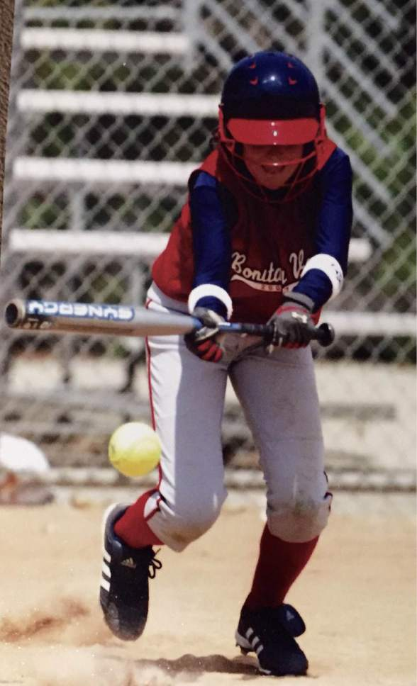 |  Courtesy Mary Lou Flippen  Hannah Flippen lays down a bunt during her youth softball days. Now a junior second baseman at Utah, Flippen is leading the Utes in batting average, slugging percentage and home runs.
