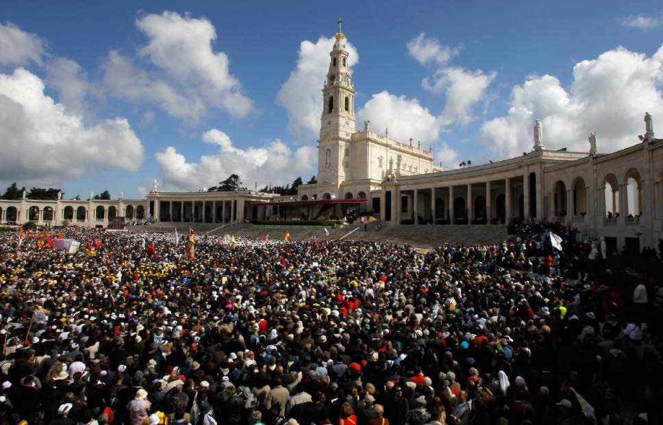 FILE - In this May 13, 2010 file photo, faithful attend mass celebrated by Pope Benedict XVI at Fatima's Sanctuary, Portugal. Pope Francis is visiting the Fatima shrine on May 12 and 13 to canonize two Portuguese shepherd children who say they saw visions of the Virgin Mary 100 years ago. (AP Photo/Victor R. Caivano, file)