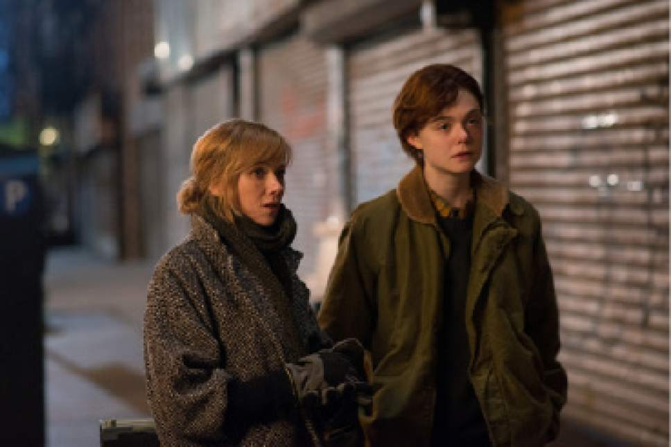 "Ray (Elle Fanning, right), a trans teen boy, is accompanied by his mom Maggie (Naomi Watts) to retrieve something from a New York alley, in the drama ""3 Generations."" Courtesy The Weinstein Company"