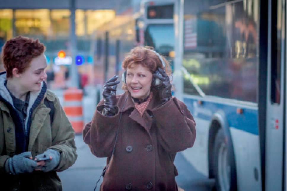 """Ray (Elle Fanning, left), a trans teen boy, shares some music with his grandmother, Dolly (Susan Sarandon), in the drama """"3 Generations."""" Courtesy The Weinstein Company"""