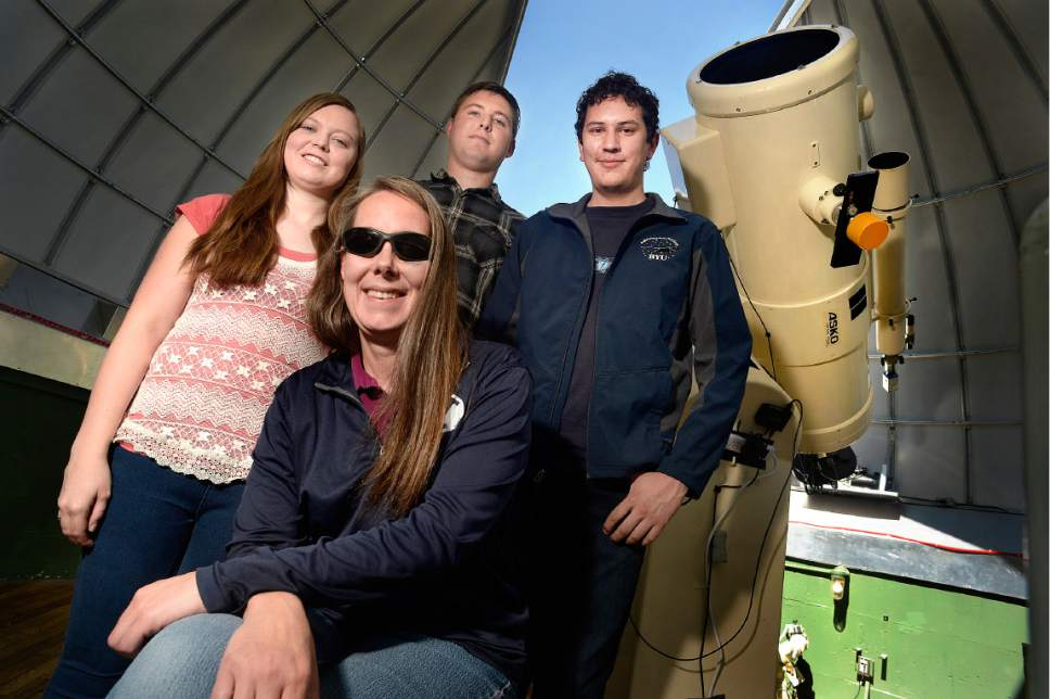 Scott Sommerdorf | The Salt Lake Tribune Professor Denise Stephens, foreground with BYU students Leeanne Farnbach, left, Andrew Patterson, center, and Kyle Matt, right, who discovered a new planet while working on a class project with the school's 16 inch Cassegrain telescope, Thursday, May 4, 2017.