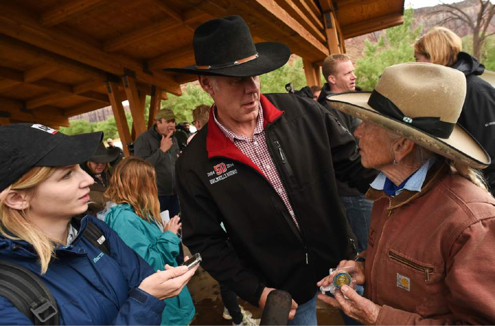 U.S. Interior Secretary Ryan Zinke, center, thanks Heidi Reed during his visit to historic Dugout Ranch along Indian Creek near Monticello, Utah, operated by Redd, under a conservation easement with the Nature Conservancy. Zinke's is touring two monuments in Utah this week as part of a review ordered by President Donald Trump of 27 monuments to determine if they were properly designated. (Francisco Kjolseth/The Salt Lake Tribune via AP)