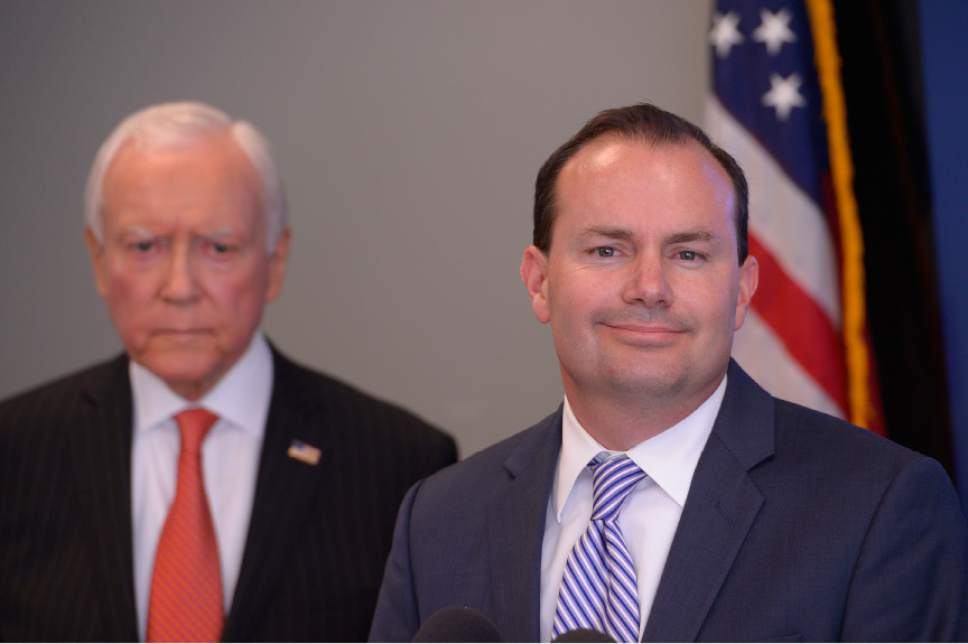 Leah Hogsten  |  Tribune file photo l-r Sens. Orrin Hatch and Mike Lee, shown here during a 2014 news conference, are often at odds on issues that pit the establishment GOP against hard-line conservatives. But on the issue of criminal justice reform, they've done a role reversal.