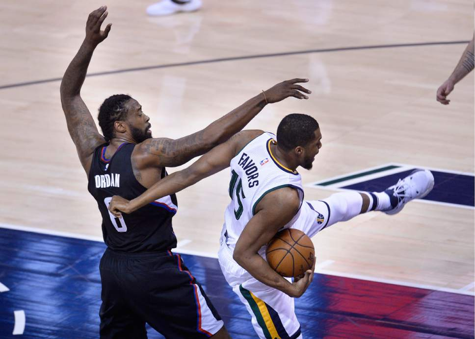 Scott Sommerdorf | The Salt Lake Tribune Utah Jazz forward Derrick Favors (15) gets tangled up with LA Clippers center DeAndre Jordan (6) during this first quarter rebound. The Utah Jazz trailed the LA Clipper 26-24 at the end of the first period of Game 4 of the Western Conference playoffs, Sunday, April 23, 2017.