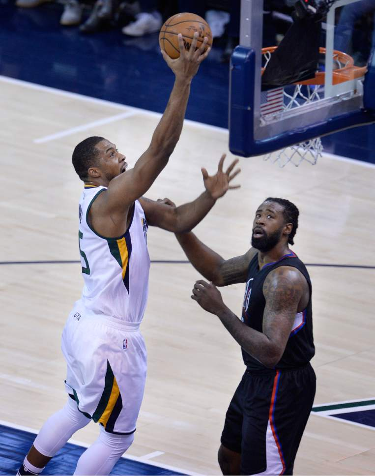 Scott Sommerdorf | The Salt Lake Tribune Utah Jazz forward Derrick Favors (15) scores over LA Clippers center DeAndre Jordan (6) during first quarter play. The Utah Jazz trailed the LA Clipper 26-24 at the end of the first period of Game 4 of the Western Conference playoffs, Sunday, April 23, 2017.