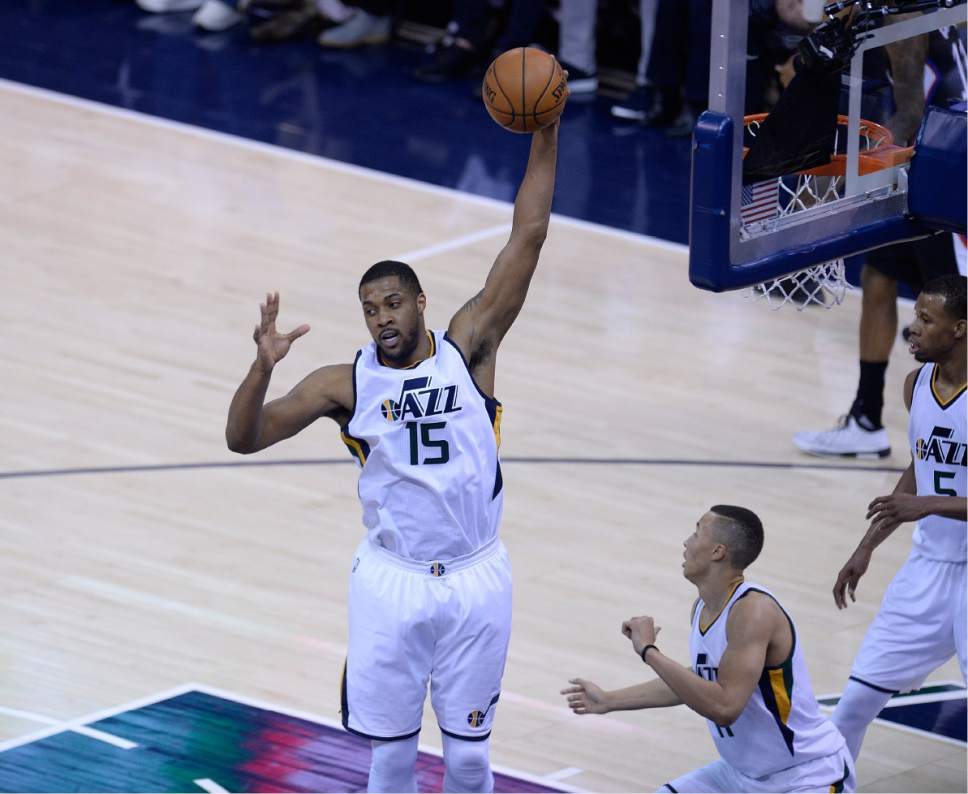 Scott Sommerdorf | The Salt Lake Tribune Utah Jazz forward Derrick Favors (15) rips down a rebound during second half play. The Utah Jazz beat the LA Clipper 105-98 to take Game 4 and tie up the Western Conference playoff series at 2-2, Sunday, April 23, 2017.