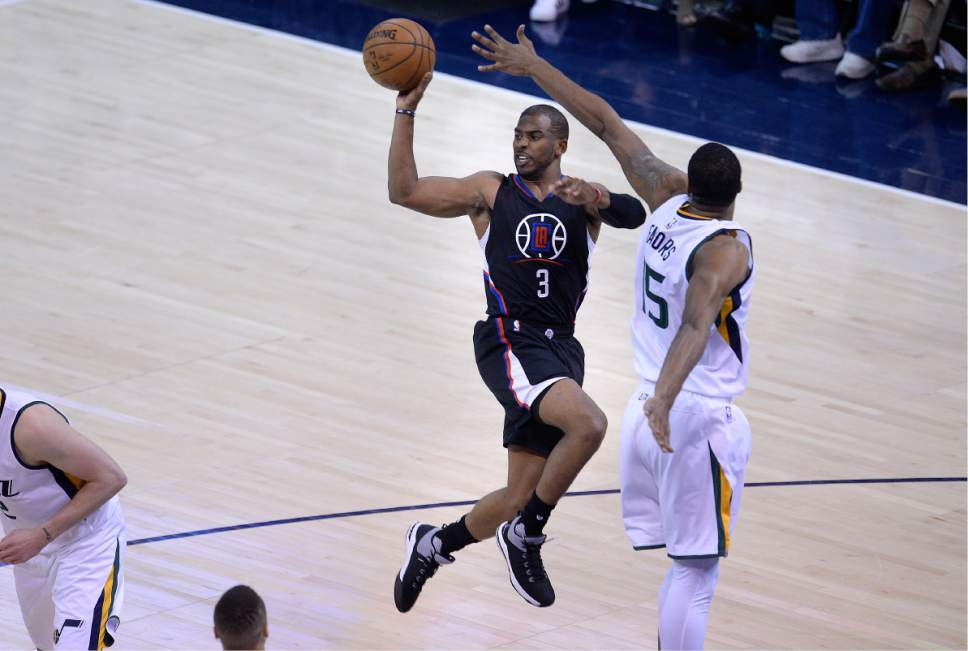 Scott Sommerdorf | The Salt Lake Tribune LA Clippers guard Chris Paul (3) passes after driving against Utah Jazz forward Derrick Favors (15) during second half play. The Utah Jazz beat the LA Clipper 105-98 to take Game 4 and tie up the Western Conference playoff series at 2-2, Sunday, April 23, 2017.