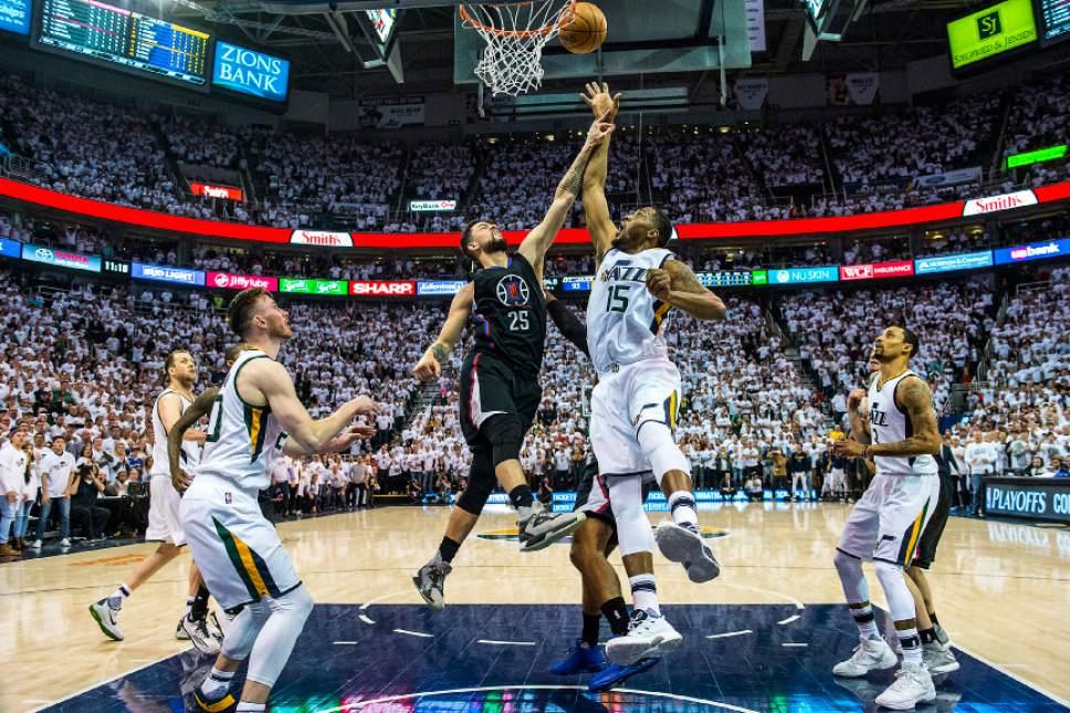 Chris Detrick  |  The Salt Lake Tribune Utah Jazz forward Derrick Favors (15) and LA Clippers guard Austin Rivers (25) go for a rebound during the game at Vivint Smart Home Arena Friday, April 28, 2017.  LA Clippers defeated Utah Jazz 98-93.