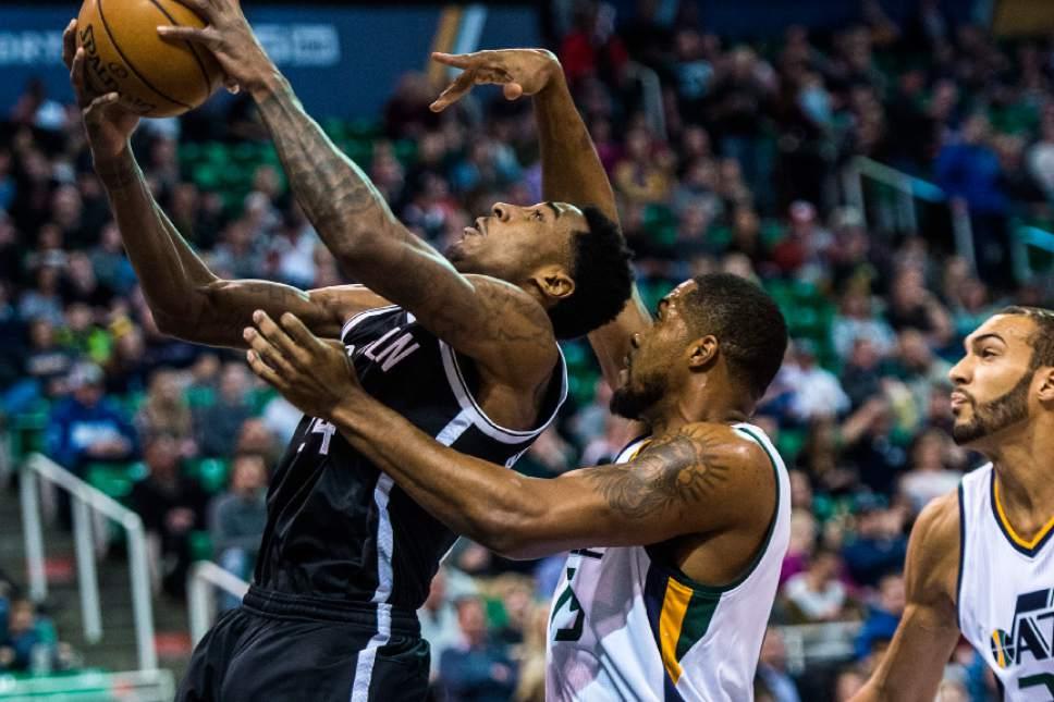 Chris Detrick  |  The Salt Lake Tribune Utah Jazz forward Derrick Favors (15) guards Brooklyn Nets forward Rondae Hollis-Jefferson (24) during the game at Vivint Smart Home Arena Friday March 3, 2017.