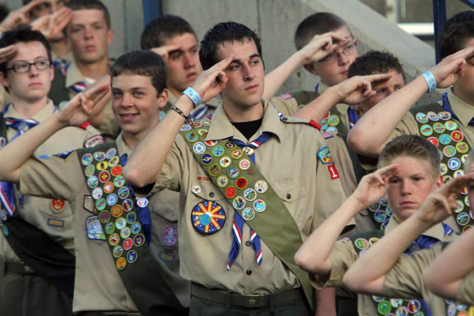 Rick Egan      Tribune file photo                                                                                   Boy Scouts salute during Provo's Stadium of Fire on Saturday, July 3, 2010.