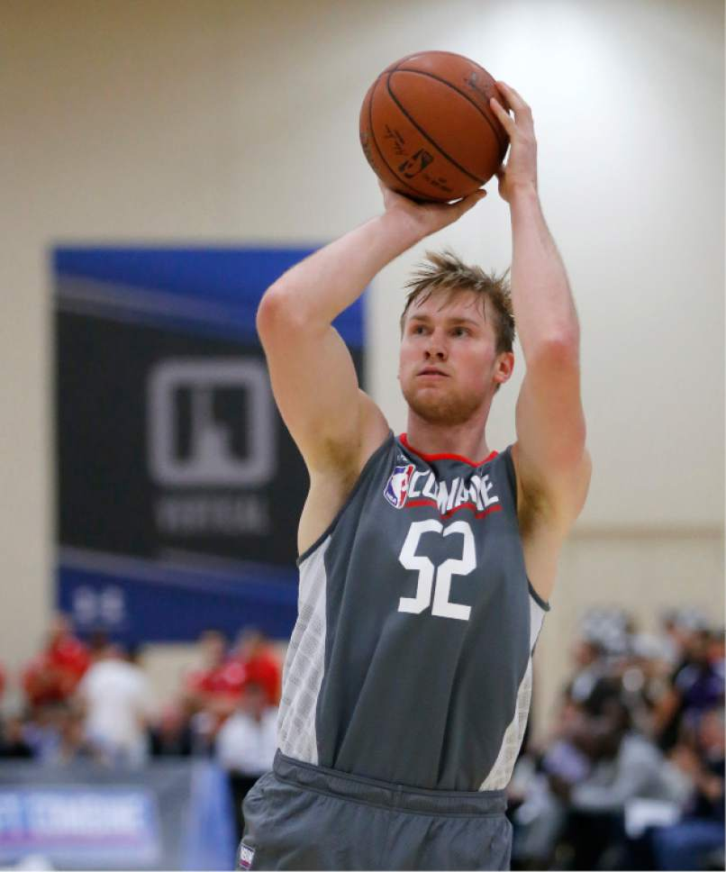 Eric Mika, from BYU, takes a shot during the NBA draft basketball combine Thursday, May 11, 2017, in Chicago. (AP Photo/Charles Rex Arbogast)