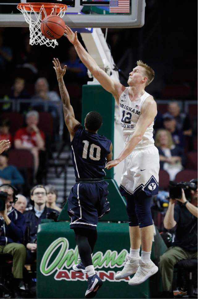 BYU's Eric Mika, right, guards Loyola Marymount's Brandon Brown during the first half of a West Coast Conference tournament NCAA college basketball game Saturday, March 4, 2017, in Las Vegas. (AP Photo/John Locher)