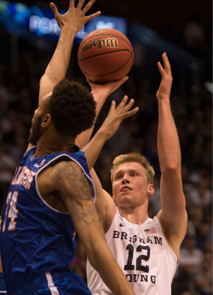 Rick Egan  |  Tribune file photo BYU center Eric Mika, shooting over UT Arlington's Faith Pope in the NIT last week, says he expects to be drafted and hopes to play power forward in the NBA.