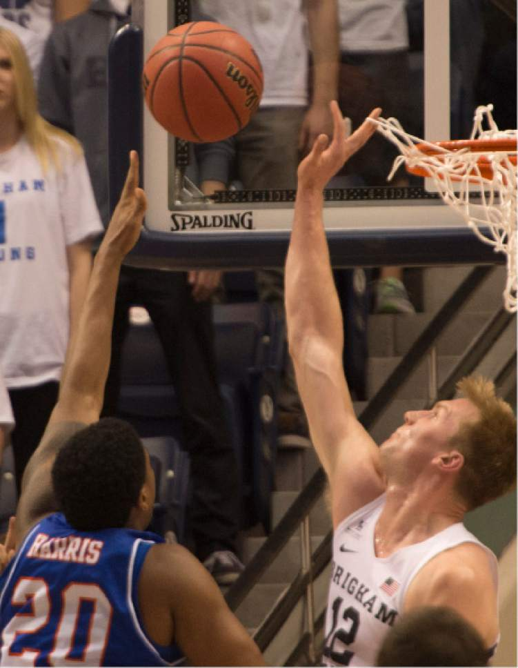 Rick Egan  |  The Salt Lake Tribune  Texas-Arlington Mavericks forward Julian Harris (20) goes to the hoop as Brigham Young Cougars forward Eric Mika (12) defends, in NIT basketball action Brigham Young Cougars vs. Texas-Arlington Mavericks, at the Marriott Center, Wednesday, March 15, 2017.
