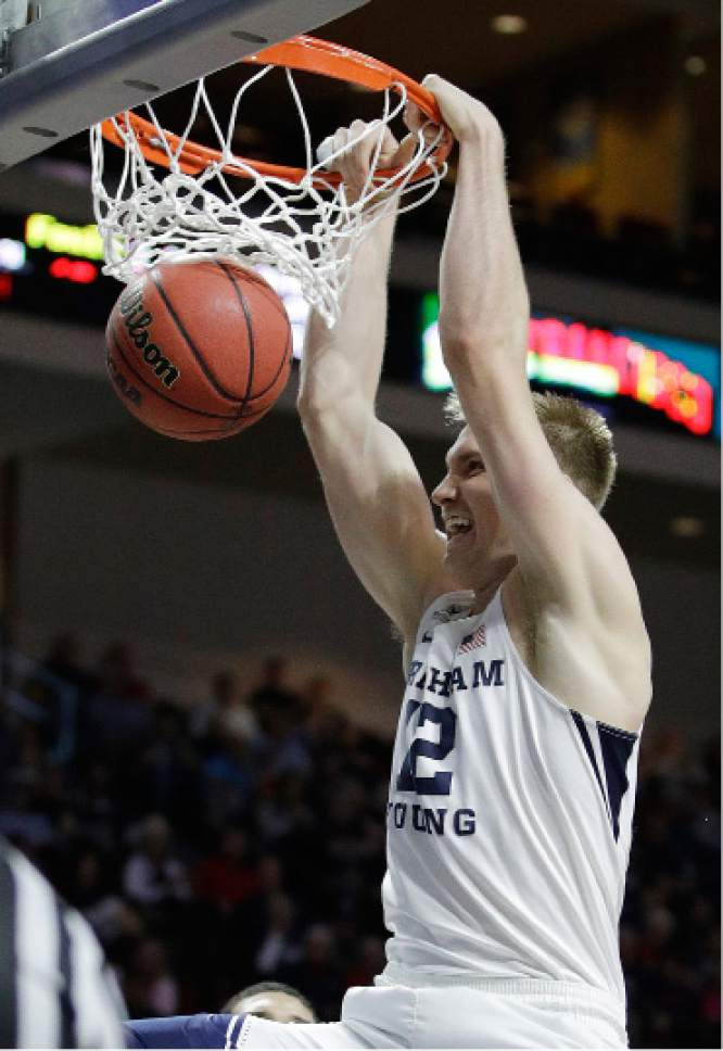 BYU's Eric Mika dunks against Loyola Marymount during the first half of a West Coast Conference tournament NCAA college basketball game Saturday, March 4, 2017, in Las Vegas. (AP Photo/John Locher)