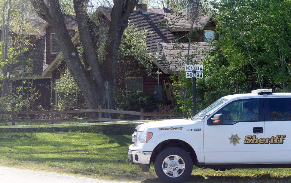 Al Hartmann     The Salt Lake Tribune Weber County sheriff's deputies investigate a homicide at a residential home in the 7400 East block of 400 South in Huntsville Thursday morning May 11.