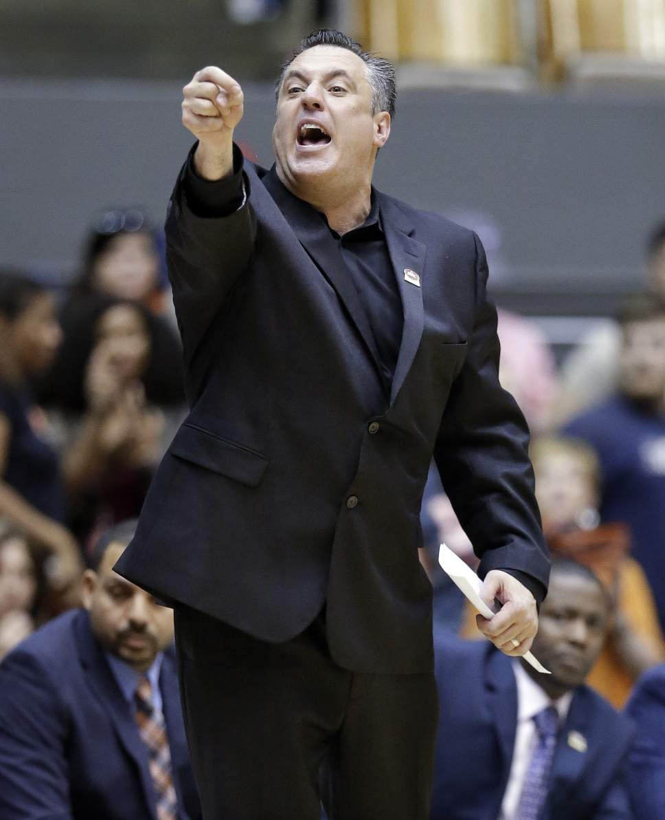 UT Martin head coach Heath Schroyer yells to his team in the first half of an NCAA college basketball game against Austin Peay at the championship of the Ohio Valley Conference basketball tournament Saturday, March 5, 2016, in Nashville, Tenn. (AP Photo/Mark Humphrey)