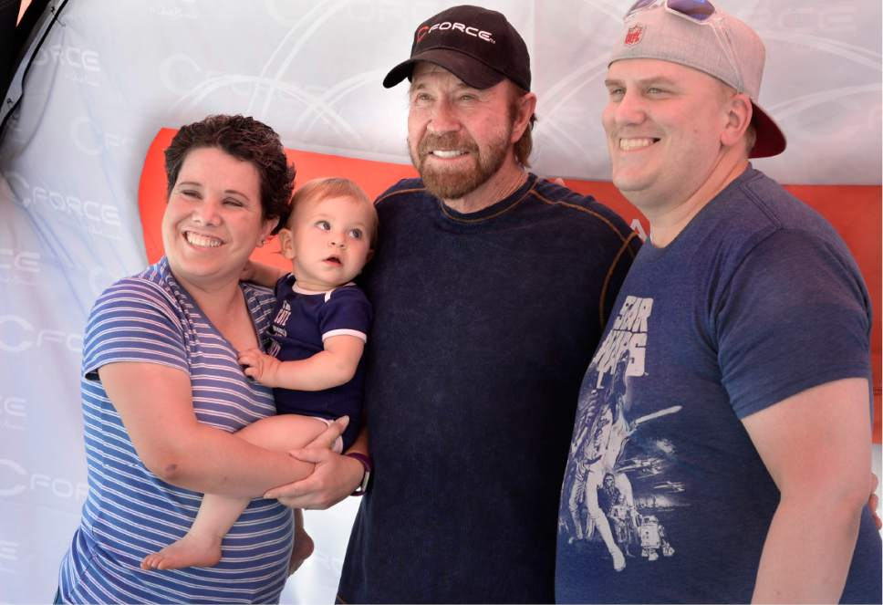 Scott Sommerdorf | The Salt Lake Tribune 10-month old Josie Sansom looks up to actor Chuck Norris while posing for a photo with her parents as Norris made an appearance at the State Street Maverick in Provo, Thursday, May 10, 2017.