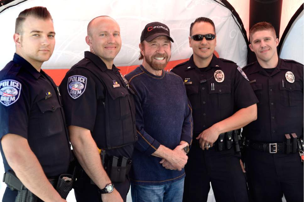 Scott Sommerdorf  |  The Salt Lake Tribune Actor Chuck Norris posed for a photo with a group of Orem police officers as he made an appearance at the State Street Maverick in Provo on Thursday.