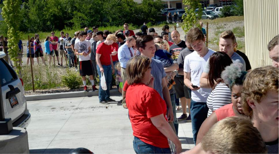 Scott Sommerdorf  |  The Salt Lake Tribune Scores of people lined up to see actor Chuck Norris and have their photo taken with him as he made an appearance at the State Street Maverick in Provo Thursday.