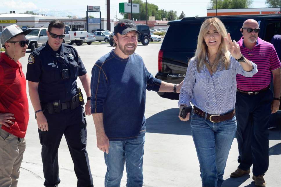 "Scott Sommerdorf | The Salt Lake Tribune Arriving with his wife Gina, right, actor Chuck Norris made a stop to promote the couple's ""C-Force"" water at the State Street Maverick in Provo, Thursday, May 10, 2017."