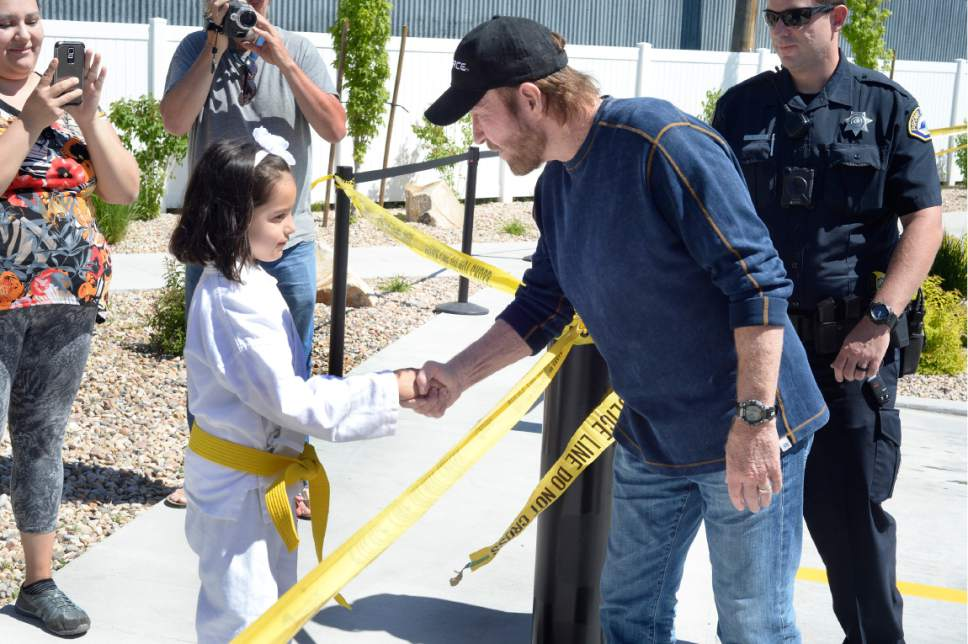 Scott Sommerdorf | The Salt Lake Tribune Actor Chuck Norris stopped to shake the hands of a young girl wearing a gi as he made an appearance at the State Street Maverick in Provo, Thursday, May 10, 2017.
