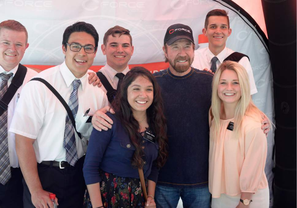 Scott Sommerdorf | The Salt Lake Tribune Among the hundreds of people he posed with, actor Chuck Norris posed with a group of LDS missionaries at the State Street Maverick in Provo, Thursday, May 10, 2017.
