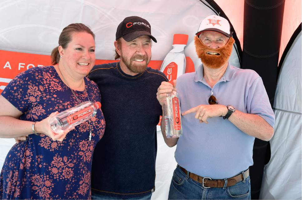 Scott Sommerdorf | The Salt Lake Tribune Amanda Baker, left, and Steve Baker, right wearing his Chuck Norris hat & beard combo posed for a photo with actor Chuck Norris as he made an appearance at the State Street Maverick in Provo, Thursday, May 10, 2017. The Bakers made the trip from Rock Springs, Wyoming for the event.